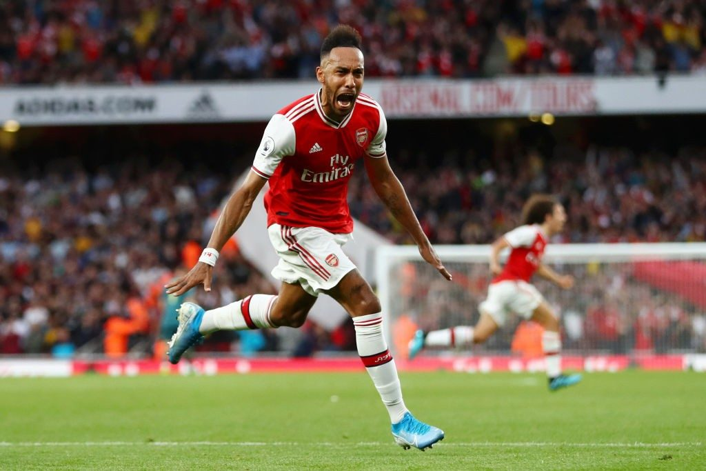 LONDON, ENGLAND - SEPTEMBER 22: Pierre-Emerick Aubameyang of Arsenal celebrates scoring his team's third goal during the Premier League match between Arsenal FC and Aston Villa at Emirates Stadium on September 22, 2019, in London, United Kingdom. (Photo by Michael Steele/Getty Images)