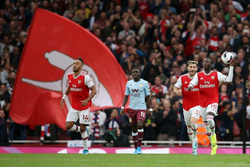 LONDON, ENGLAND - SEPTEMBER 22: Nicolas Pepe of Arsenal celebrates after scoring his team's first goal during the Premier League match between Arsenal FC and Aston Villa at Emirates Stadium on September 22, 2019, in London, United Kingdom. (Photo by Steve Bardens/Getty Images)