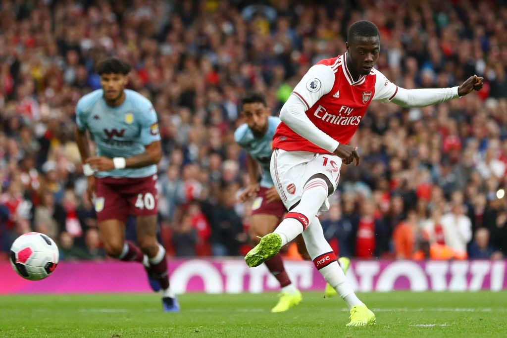 LONDON, ENGLAND - SEPTEMBER 22: Nicolas Pepe of Arsenal converts his sides penalty and scores their first goal of the game during the Premier League match between Arsenal FC and Aston Villa at Emirates Stadium on September 22, 2019, in London, United Kingdom. (Photo by Michael Steele/Getty Images)