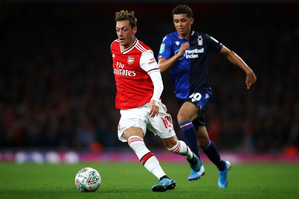 LONDON, ENGLAND - SEPTEMBER 24: Mesut Ozil of Arsenal gets past the tackle from Brennan Johnson of Nottingham Forest during the Carabao Cup Third Round match between Arsenal FC and Nottingham Forrest at Emirates Stadium on September 24, 2019, in London, England. (Photo by Julian Finney/Getty Images)
