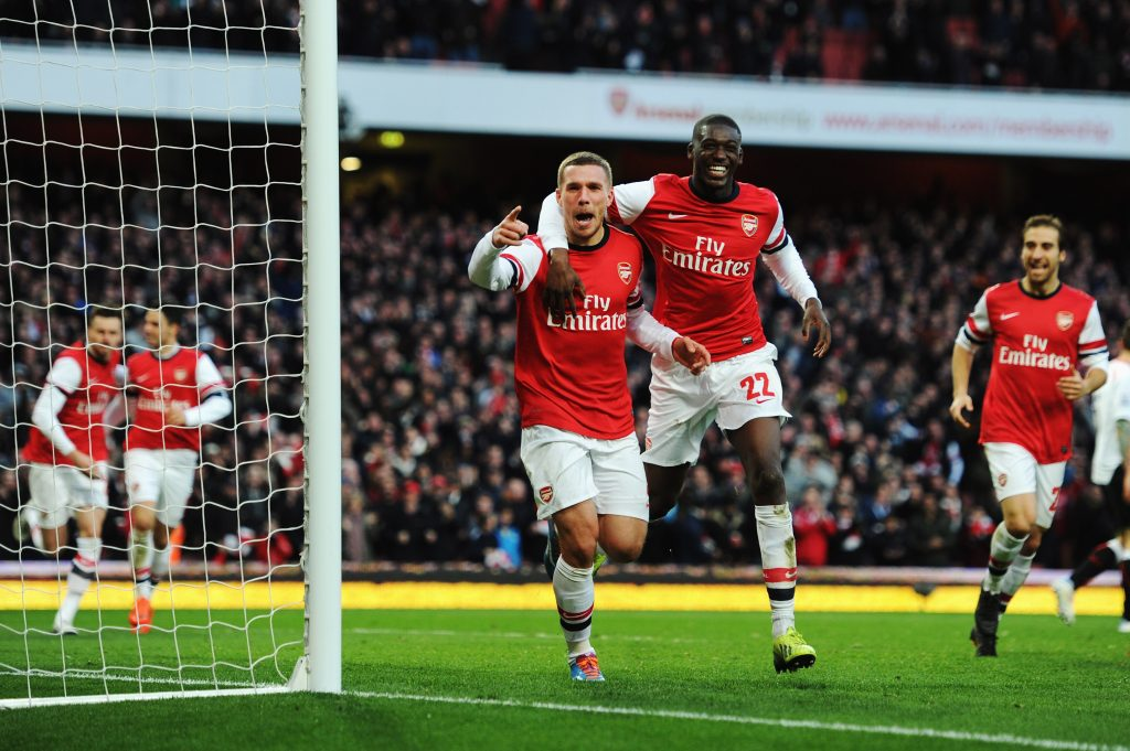 LONDON, ENGLAND - FEBRUARY 16: Lukas Podolski (L) of Arsenal celebrates with team mate Yaya Sanogo after scoring during the FA Cup Fifth Round match between Arsenal and Liverpool at the Emirates Stadium on February 16, 2014, in London, England. (Photo by Shaun Botterill/Getty Images)