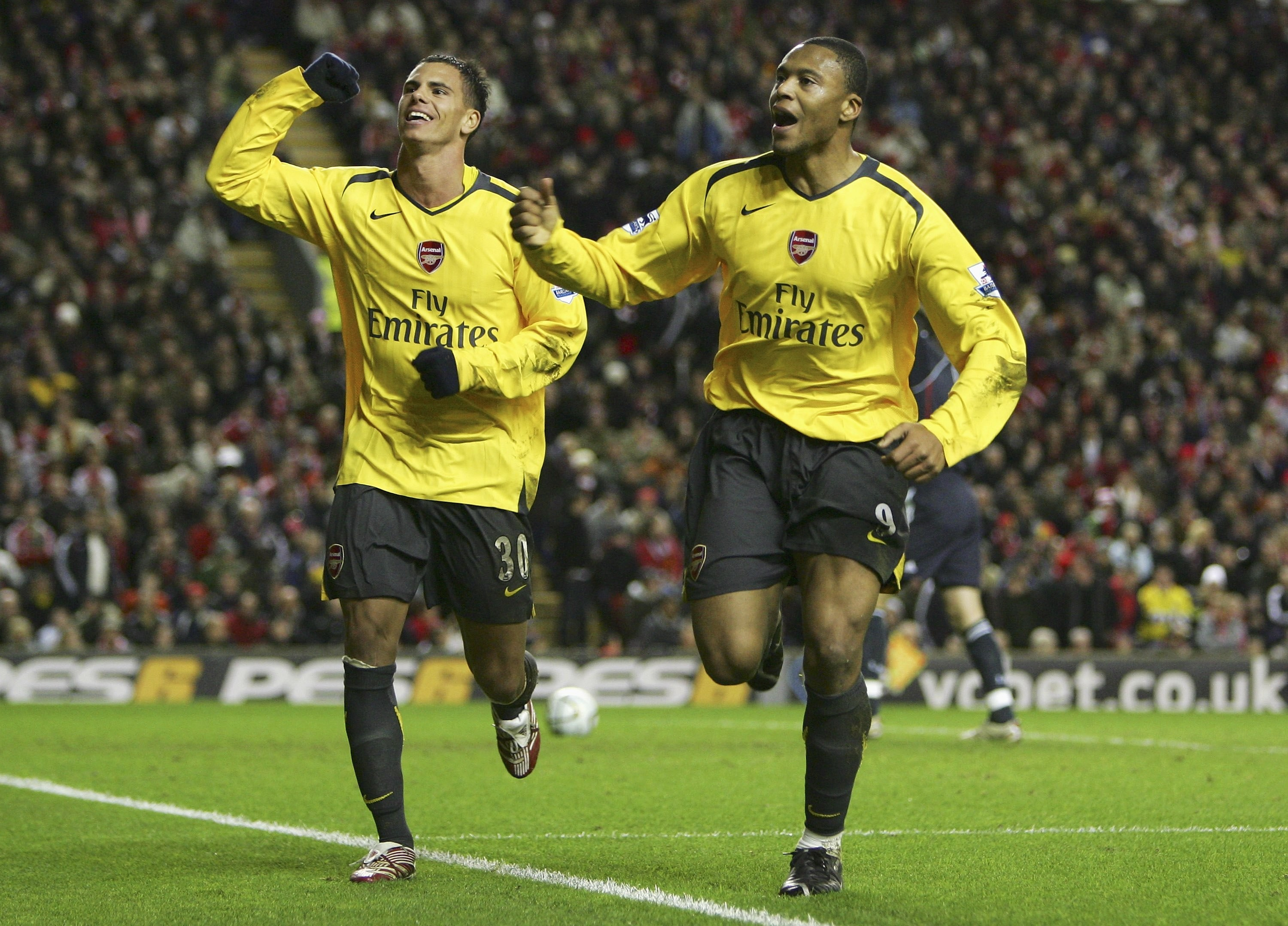LIVERPOOL, UNITED KINGDOM - JANUARY 09: Julio Baptista (R) of Arsenal celebrates scoring his team's fifth goal to complete his hat trick with team mate Jeremie Aliadiere during the Carling Cup quarter final match between Liverpool and Arsenal at Anfield on January 9, 2007, in Liverpool, England. (Photo by Alex Livesey/Getty Images)