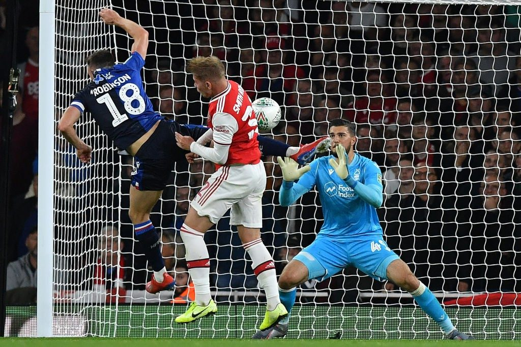 Nottingham Forest's Swiss-born Kosovan goalkeeper Arijanet Muric (R) saves a shot from Arsenal's English midfielder Emile Smith Rowe (C) as he clashes with Nottingham Forest's English defender Jack Robinson during the English League Cup third round football match between Arsenal and Nottingham Forest at the Emirates Stadium in London on September 24, 2019. (Photo by Ben STANSALL / AFP / Getty Images)
