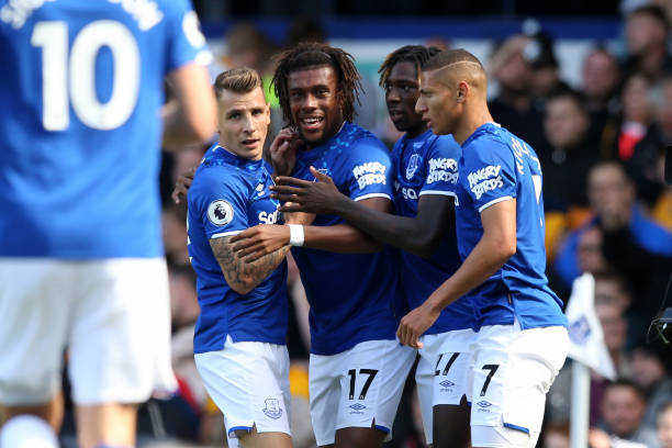 LIVERPOOL, ENGLAND - SEPTEMBER 01: Alex Iwobi of Everton celebrates with teammates after scoring his team's second goal during the Premier League match between Everton FC and Wolverhampton Wanderers at Goodison Park on September 01, 2019 in Liverpool, United Kingdom. (Photo by Jan Kruger/Getty Images)
