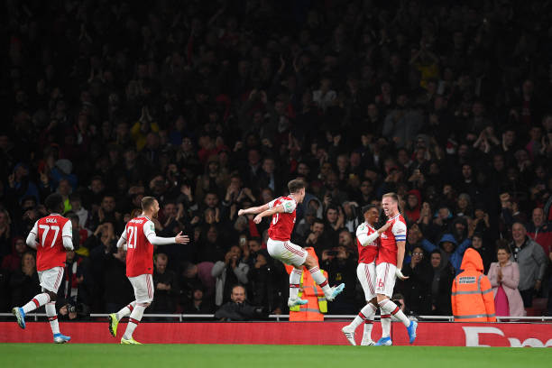LONDON, ENGLAND - SEPTEMBER 24: Rob Holding of Arsenal celebrates scoring his teams second goal of the game with team mates during the Carabao Cup Third Round match between Arsenal FC and Nottingham Forrest at Emirates Stadium on September 24, 2019 in London, England. (Photo by Laurence Griffiths/Getty Images)