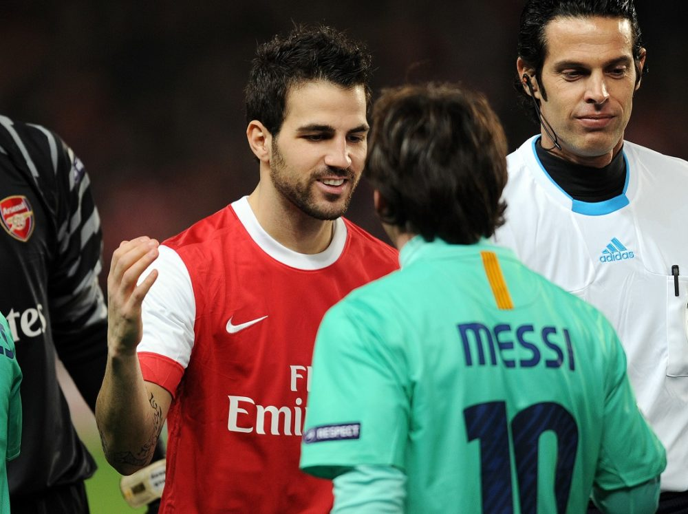 Arsenal's Spanish midfielder Cesc Fabregas (L) greets Barcelona's Argentine striker Lionel Messi (R) before their UEFA Champions League round of 16, 1st leg football match against Barcelona at the Emirates Stadium, London, England, on February 16, 2011. AFP PHOTO/ADRIAN DENNIS