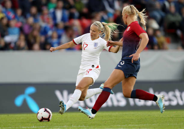 BERGEN, NORWAY - SEPTEMBER 03: Beth Mead of England runs with the ball while pressured by Maria Thorisdottir of Norway during the International Friendly match between Norway Women and England Women at Brann Stadion on September 03, 2019 in Bergen, Norway. (Photo by Linnea Rheborg/Getty Images) (Photo by Linnea Rheborg/Getty Images)