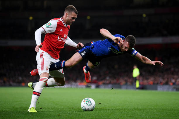 LONDON, ENGLAND - SEPTEMBER 24: Calum Chambers of Arsenal battles for the ball with Jack Robinson of Nottingham Forest during the Carabao Cup Third Round match between Arsenal FC and Nottingham Forrest at Emirates Stadium on September 24, 2019 in London, England. (Photo by Laurence Griffiths/Getty Images)