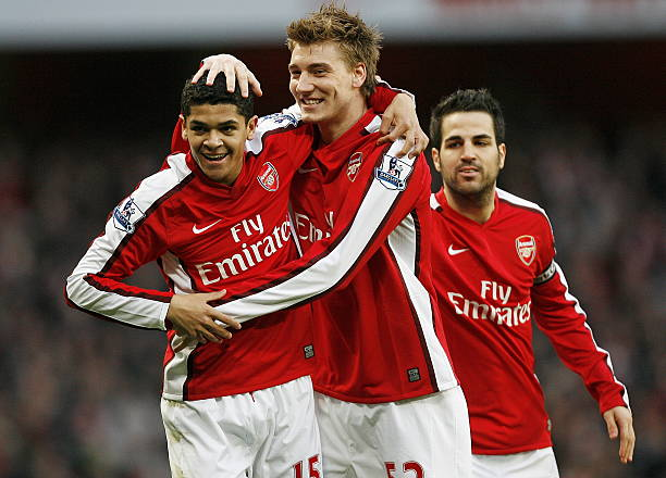 Arsenal's Brazilian midfielder Denilson (L) celebrates scoring the opening goal with Danish striker Nicklas Bendtner (2nd L) during the English Premier League football match between Arsenal and West Ham United at the Emirates stadium, north London on March 20, 2010. AFP PHOTO/GLYN KIRK