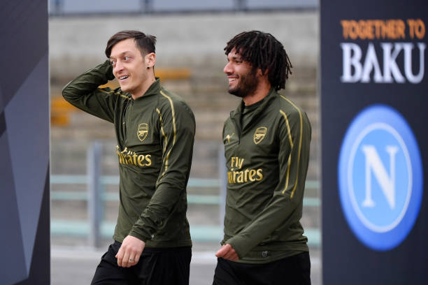 NAPLES, ITALY - APRIL 17: Mesut Ozil and Mohamed Elneny of Arsenal looks on during an Arsenal training session ahead of their UEFA Europa League quarter-final second leg match against SSC Napoli. At Stadio San Paolo on April 17, 2019 in Naples, Italy. (Photo by Stuart Franklin/Getty Images)