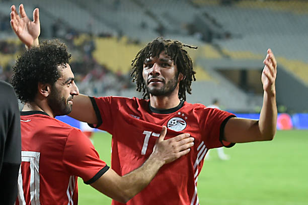 Egypt's midfielder Mohamed Elneny (R) celebrates with Egypt's forward Mohamed Salah (L) after one of their teammate scored a goal during the Africa Cup of Nations qualifier football match Egypt vs Tunisia at the Borg El Arab Stadium, near Alexandria, on November 16, 2018. (Photo by KHALED DESOUKI / AFP)