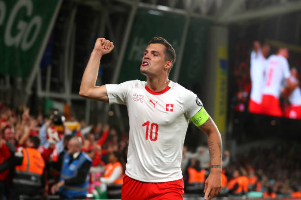 DUBLIN, IRELAND - SEPTEMBER 05: Granit Xhaka of Switzerland celebrates the goal of Fabian Schar during the UEFA Euro 2020 qualifier between Republic of Ireland and Switzerland at Aviva Stadium on September 05, 2019 in Dublin, Ireland. (Photo by Catherine Ivill/Getty Images)