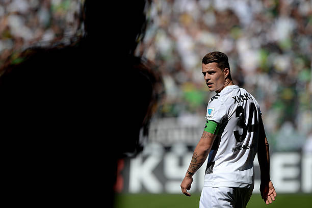 MOENCHENGLADBACH, GERMANY - MAY 07: Granit Xhaka of Moenchengladbach looks on during the Bundesliga match between Borussia Moenchengladbach and Bayer Leverkusen at Borussia-Park on May 07, 2016 in Moenchengladbach, Germany. (Photo by Sascha Steinbach/Bongarts/Getty Images)DUBLIN, IRELAND - SEPTEMBER 05: Granit Xhaka of Switzerland celebrates the goal of Fabian Schar during the UEFA Euro 2020 qualifier between Republic of Ireland and Switzerland at Aviva Stadium on September 05, 2019 in Dublin, Ireland. (Photo by Catherine Ivill/Getty Images)