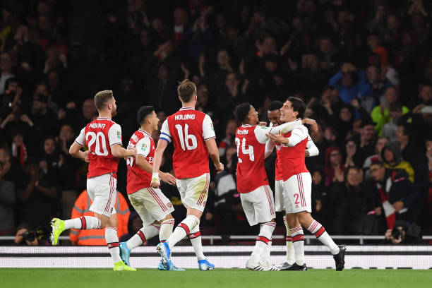 LONDON, ENGLAND - SEPTEMBER 24: Joe Willock of Arsenal celebrates scoring his teams third goal of the game with team mate Hector Bellerin during the Carabao Cup Third Round match between Arsenal FC and Nottingham Forrest at Emirates Stadium on September 24, 2019 in London, England. (Photo by Laurence Griffiths/Getty Images)