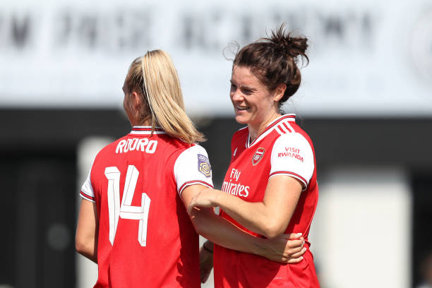 BOREHAMWOOD, ENGLAND - AUGUST 25: Jennifer Beattie of Arsenal celebrates with team mate Jill Roord of Arsenal after scoring her team's second goal during the pre season friendly match between Arsenal Women and Tottenham Hotspur Women at Meadow Park on August 25, 2019 in Borehamwood, England. (Photo by Linnea Rheborg/Getty Images)