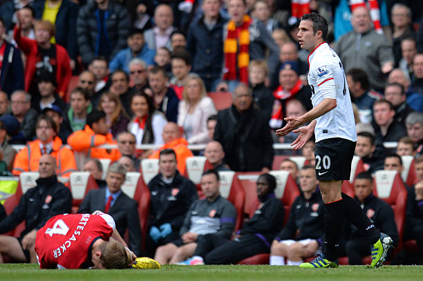 LONDON, ENGLAND - APRIL 28: Robin van Persie of Manchester United appeals to the referee after he fouled Per Mertesacker of Arsenal during the Barclays Premier League match between Arsenal and Manchester United at Emirates Stadium on April 28, 2013 in London, England. (Photo by Shaun Botterill/Getty Images)