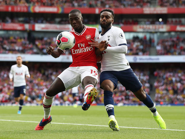 LONDON, ENGLAND - SEPTEMBER 01: Nicolas Pepe of Arsenal battle with Danny Rose of Spurs during the Premier League match between Arsenal FC and Tottenham Hotspur at Emirates Stadium on September 01, 2019 in London, United Kingdom. (Photo by Julian Finney/Getty Images)