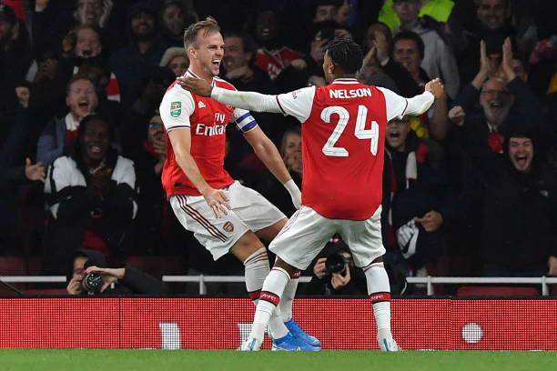 Arsenal's English defender Rob Holding (L) celebrates scoring his team's second goal during the English League Cup third round football match between Arsenal and Nottingham Forest at the Emirates Stadium in London on September 24, 2019. (Photo by Ben STANSALL / AFP)