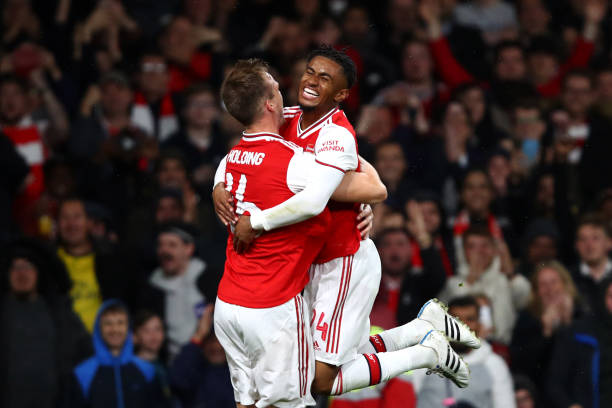 LONDON, ENGLAND - SEPTEMBER 24: Rob Holding of Arsenal celebrates scoring his teams second goal of the game with team mate Reiss Nelson during the Carabao Cup Third Round match between Arsenal FC and Nottingham Forrest at Emirates Stadium on September 24, 2019 in London, England. (Photo by Julian Finney/Getty Images)