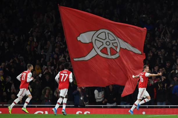 Arsenal's English defender Rob Holding (R) celebrates scoring his team's second goal during the English League Cup third round football match between Arsenal and Nottingham Forest at the Emirates Stadium in London on September 24, 2019. (Photo by Ben STANSALL / AFP)