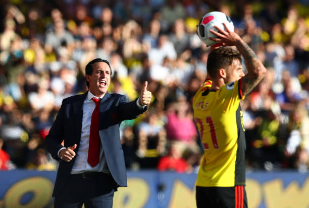 WATFORD, ENGLAND - SEPTEMBER 15: Unai Emery, Manager of Arsenal reacts as Kiko Femenia of Watford take a throw in during the Premier League match between Watford FC and Arsenal FC at Vicarage Road on September 15, 2019 in Watford, United Kingdom. (Photo by Julian Finney/Getty Images)