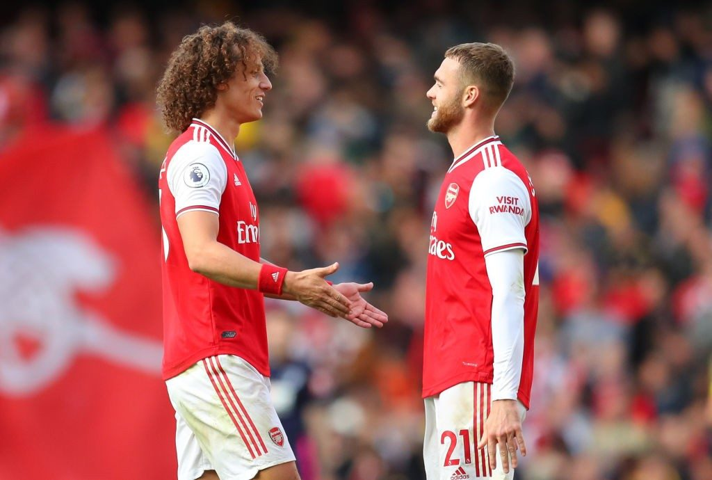 LONDON, ENGLAND - OCTOBER 06: David Luiz of Arsenal with Calum Chambers of Arsenal at the end of the Premier League match between Arsenal FC and AFC Bournemouth at Emirates Stadium on October 06, 2019, in London, United Kingdom. (Photo by Catherine Ivill/Getty Images)