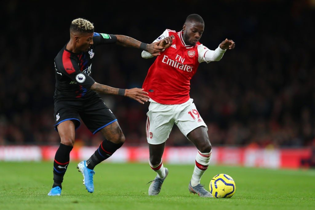 LONDON, ENGLAND - OCTOBER 27: Nicolas Pepe of Arsenal battles for possession with Patrick van Aanholt of Crystal Palace during the Premier League match between Arsenal FC and Crystal Palace at Emirates Stadium on October 27, 2019, in London, United Kingdom. (Photo by Catherine Ivill/Getty Images)