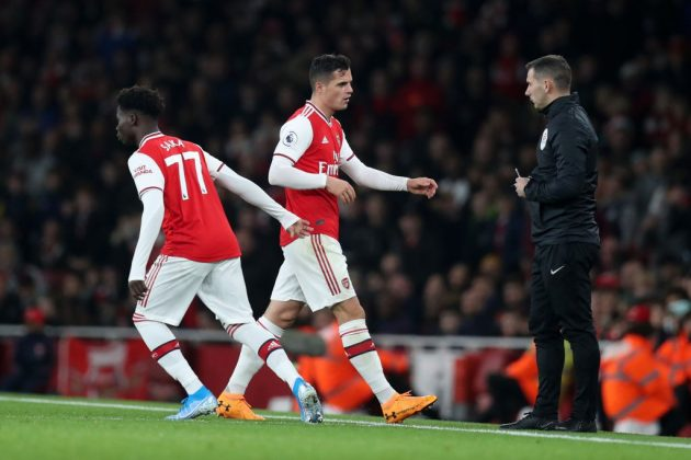 LONDON, ENGLAND - OCTOBER 27: Granit Xhaka of Arsenal is substituted off for Bukayo Saka of Arsenal during the Premier League match between Arsenal FC and Crystal Palace at Emirates Stadium on October 27, 2019, in London, United Kingdom. (Photo by Alex Morton/Getty Images)