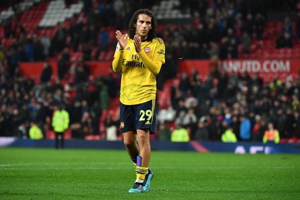 Arsenal's French midfielder Matteo Guendouzi applauds supporters on the pitch after the English Premier League football match between Manchester United and Arsenal at Old Trafford in Manchester, north west England, on September 30, 2019. - The game finished 1-1. (Photo by Paul ELLIS / AFP / Getty Images)