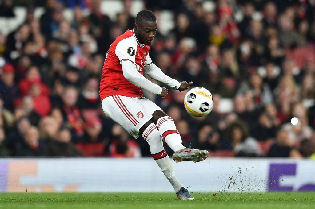 Arsenal's French-born Ivorian midfielder Nicolas Pepe takes a free-kick to scores his team's second goal during their UEFA Europa league Group F football match between Arsenal and Vitoria Guimaraes at the Emirates stadium in London on October 24, 2019. (Photo by Glyn KIRK / AFP / Getty Images)