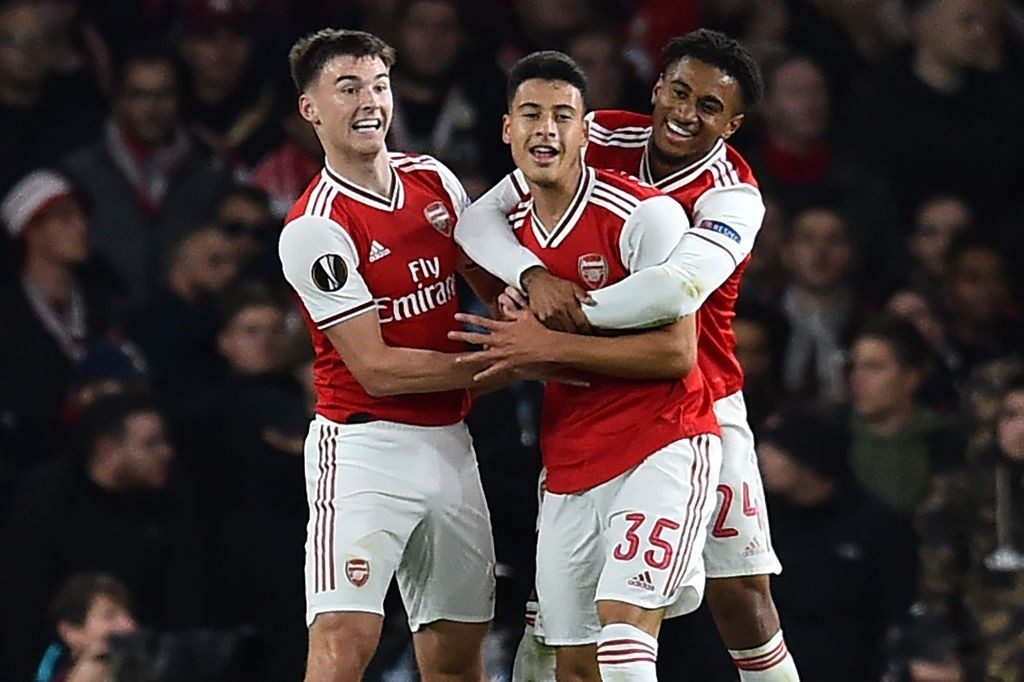 Arsenal's Brazilian striker Gabriel Martinelli (C) celebrates with teammates after scoring his second goal during the UEFA Europa League Group F football match between Arsenal and Standard Liege at the Arsenal Stadium in London on October 3, 2019. (Photo by GLYN KIRK/AFP via Getty Images)