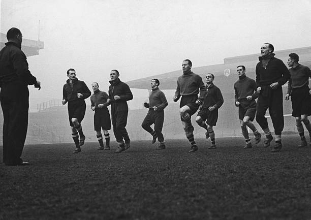 Arsenal footballers training with Tom Whittaker at the club's Highbury Stadium, late 1930s. Players include Jack Crayston, George Male, Ted Drake, Cliff Bastin, Wilf Copping and George Swindin. (Photo by Hulton Archive/Getty Images)