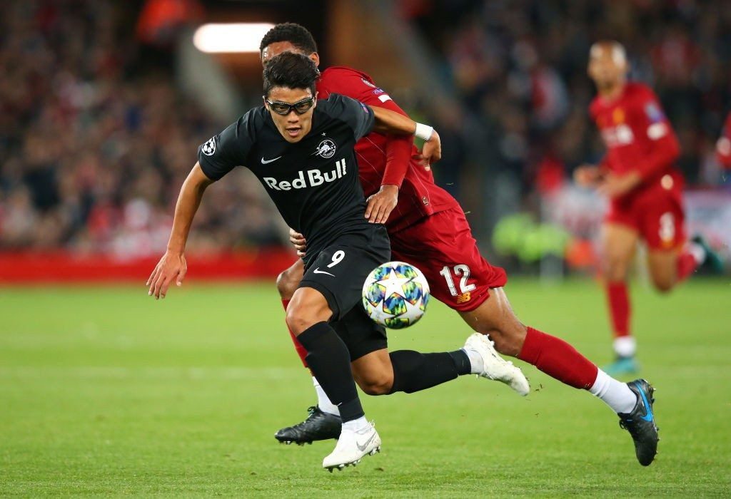 LIVERPOOL, ENGLAND - OCTOBER 02: Hwang Hee-chan of Red Bull Salzburg holds off a challenge from Joe Gomez of Liverpool during the UEFA Champions League group E match between Liverpool FC and RB Salzburg at Anfield on October 02, 2019, in Liverpool, United Kingdom. (Photo by Alex Livesey/Getty Images)