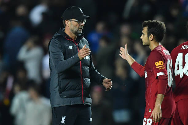 Liverpool's German manager Jurgen Klopp (L) reacts with Liverpool's Spanish midfielder Pedro Chirivella at the final whistle during the English League Cup third round football match between MK Dons and Liverpool at Stadium MK in Milton Keynes, Buckinghamshire on September 25, 2019. (Photo by Ben STANSALL / AFP) / RESTRICTED TO EDITORIAL USE. No use with unauthorized audio, video, data, fixture lists, club/league logos or 'live' services. Online in-match use limited to 120 images. An additional 40 images may be used in extra time. No video emulation. Social media in-match use limited to 120 images. An additional 40 images may be used in extra time. No use in betting publications, games or single club/league/player publications. / (Photo credit should read BEN STANSALL/AFP/Getty Images)