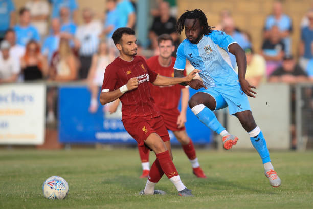 RUGBY, ENGLAND - JULY 24: Pedro Chirivella of Liverpool in action with Fankaty Dabo of Coventry City during the Pre-Season Friendly match between Coventry City and Liverpool U23 at Butlin Road on July 24, 2019 in Rugby, England. (Photo by Marc Atkins/Getty Images)