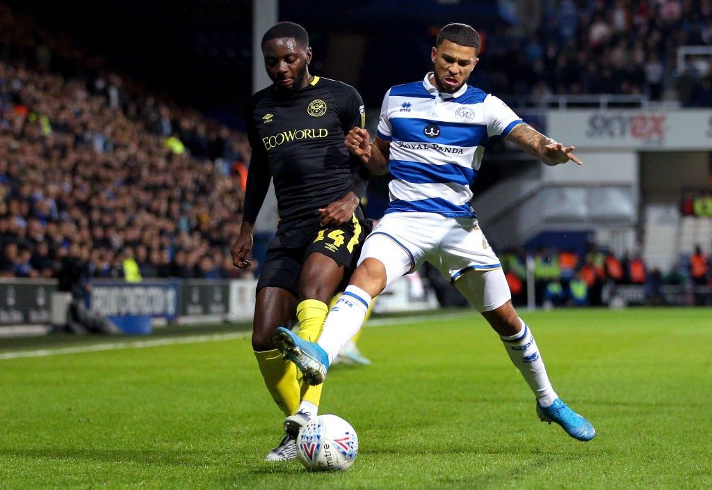 LONDON, ENGLAND - OCTOBER 28: Josh Dasilva of Brentford is challenged by Nahki Wells of Queens Park Rangers during the Sky Bet Championship match between Queens Park Rangers and Brentford at The Kiyan Prince Foundation Stadium on October 28, 2019, in London, England. (Photo by James Chance/Getty Images)