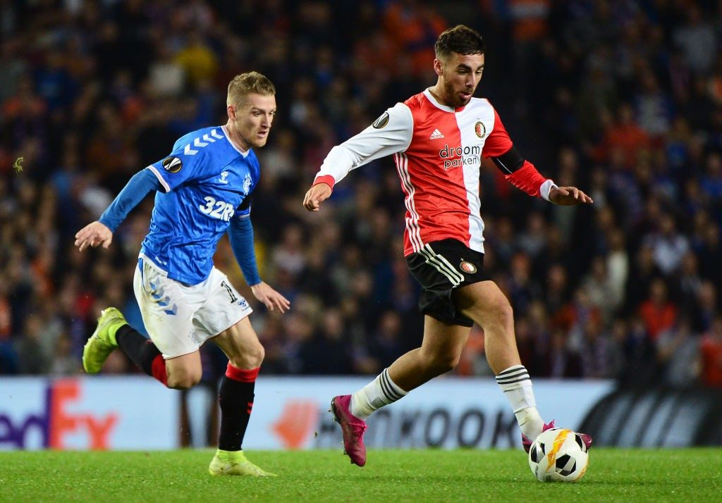 GLASGOW, SCOTLAND - SEPTEMBER 19: Orkun Kokcu of Feyenoord runs past Steven Davis of Rangers FC during the UEFA Europa League group G match between Rangers FC and Feyenoord at Ibrox Stadium on September 19, 2019, in Glasgow, United Kingdom. (Photo by Mark Runnacles/Getty Images)