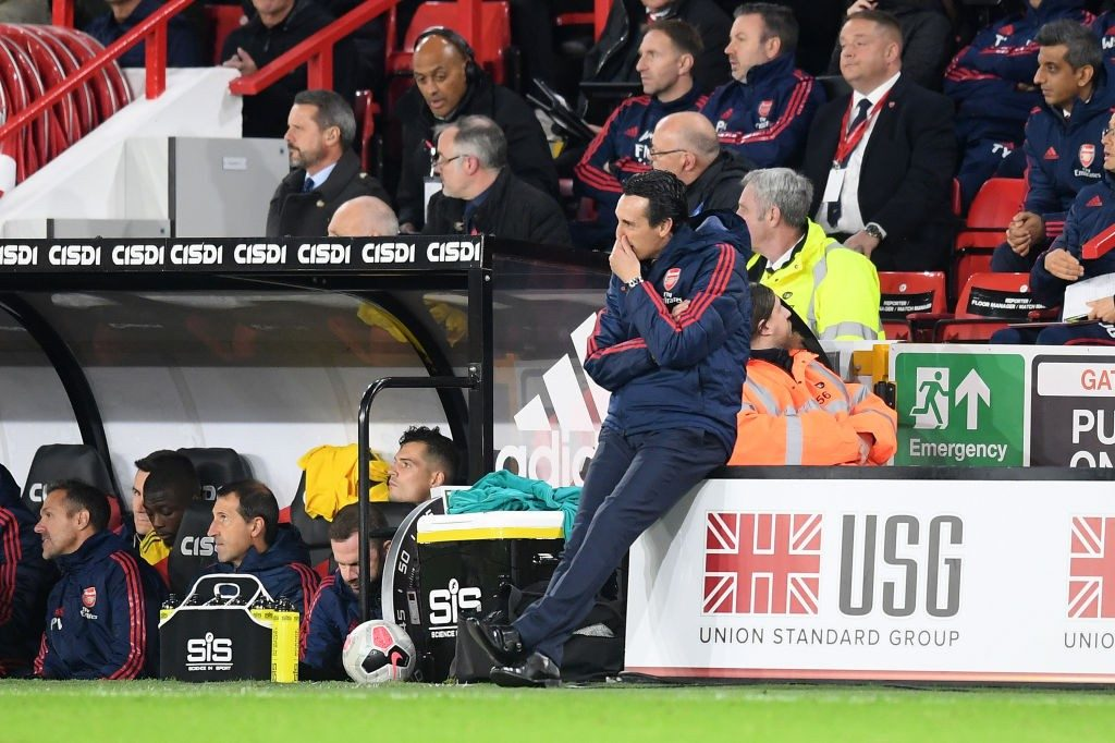 SHEFFIELD, ENGLAND - OCTOBER 21: Unai Emery, Manager of Arsenal sits on an advertising board on the sideline during the Premier League match between Sheffield United and Arsenal FC at Bramall Lane on October 21, 2019, in Sheffield, United Kingdom. (Photo by Michael Regan/Getty Images)