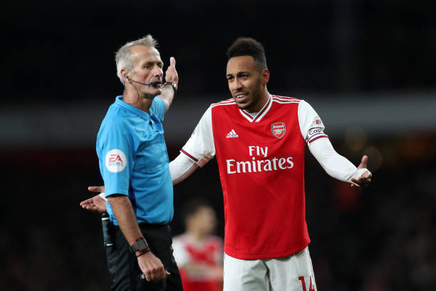 LONDON, ENGLAND - OCTOBER 27: Pierre-Emerick Aubameyang of Arsenal reacts to a decision by referee Martin Atkinson during the Premier League match between Arsenal FC and Crystal Palace at Emirates Stadium on October 27, 2019 in London, United Kingdom. (Photo by Alex Morton/Getty Images)