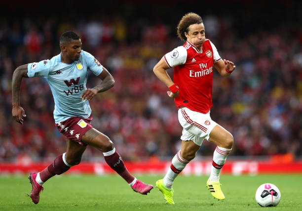 LONDON, ENGLAND - SEPTEMBER 22: David Luiz of Arsenal battles for possession with Wesley of Aston Villa during the Premier League match between Arsenal FC and Aston Villa at Emirates Stadium on September 22, 2019 in London, United Kingdom. (Photo by Michael Steele/Getty Images)