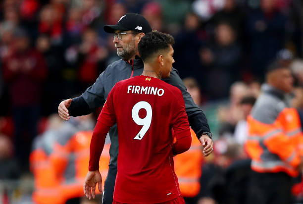 LIVERPOOL, ENGLAND - OCTOBER 05: Jurgen Klopp, Manager of Liverpool embraces Roberto Firmino of Liverpool as he comes off during the Premier League match between Liverpool FC and Leicester City at Anfield on October 05, 2019 in Liverpool, United Kingdom. (Photo by Clive Brunskill/Getty Images)