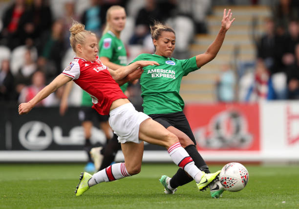 BOREHAMWOOD, ENGLAND - SEPTEMBER 29: Leonie Maier of Arsenal and Fern Whelan of Brighton & Hove Albion battle for the ball during the Barclays FA Women's Super League match between Arsenal and Brighton & Hove Albion at Meadow Park on September 29, 2019 in Borehamwood, United Kingdom. (Photo by Kate McShane/Getty Images)