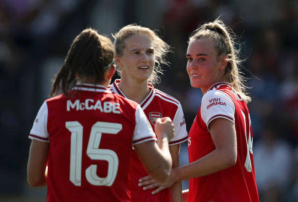 Arsenal Women international call-ups - BOREHAMWOOD, ENGLAND - AUGUST 25: Jill Roord of Arsenal celebrates with team mates Vivianne Miedema and Katie McCabe after scoring their team's fifth goal during the pre season friendly match between Arsenal Women and Tottenham Hotspur Women at Meadow Park on August 25, 2019 in Borehamwood, England. (Photo by Linnea Rheborg/Getty Images)