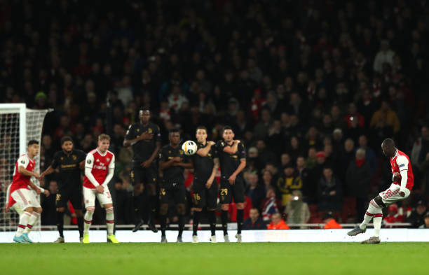LONDON, ENGLAND - OCTOBER 24: Nicolas Pepe of Arsenal scores his team's second goal during the UEFA Europa League group F match between Arsenal FC and Vitoria Guimaraes at Emirates Stadium on October 24, 2019 in London, United Kingdom. (Photo by Naomi Baker/Getty Images)