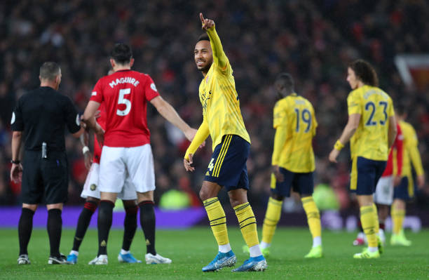 MANCHESTER, ENGLAND - SEPTEMBER 30: Pierre-Emerick Aubameyang of Arsenal celebrates after scoring his team's first goal during the Premier League match between Manchester United and Arsenal FC at Old Trafford on September 30, 2019 in Manchester, United Kingdom. (Photo by Catherine Ivill/Getty Images)