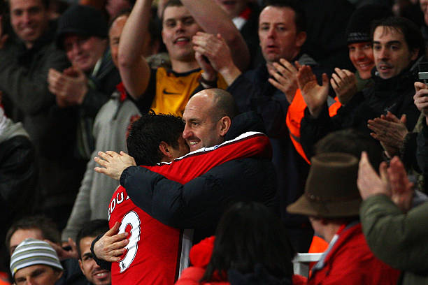 LONDON - FEBRUARY 16: Eduardo of Arsenal celebrates scoring the third goal of the game from the penalty spot with Arsenal Fitness coach Tony Colbert during the FA Cup 4th Round Replay between Arsenal and Cardiff City at the Emirates Stadium on February 16, 2009 in London, England. (Photo by Phil Cole/Getty Images)