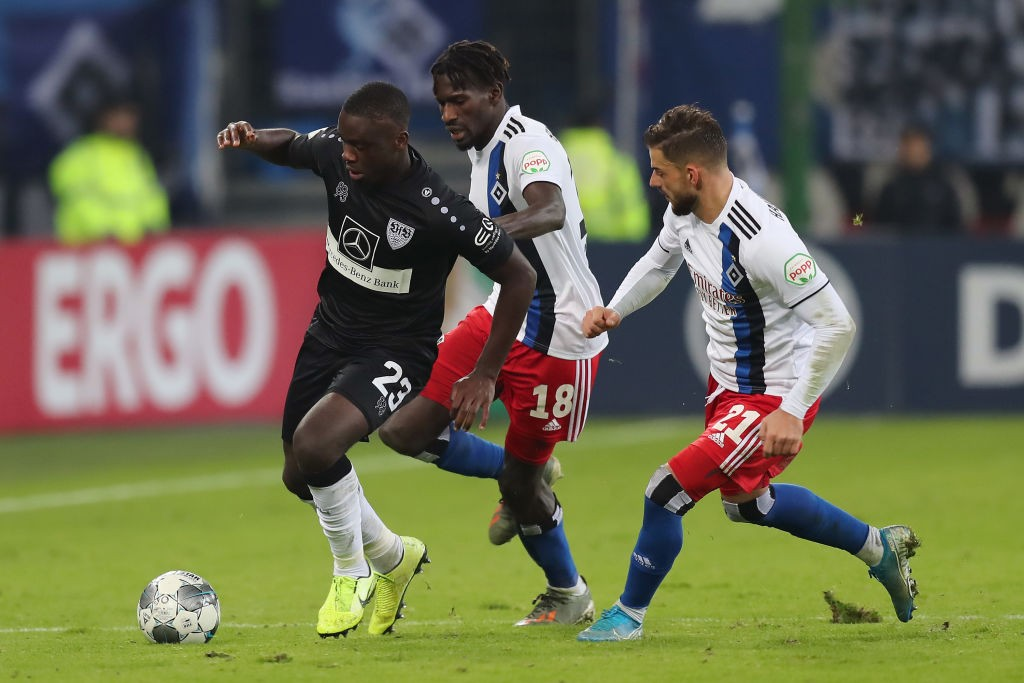 HAMBURG, GERMANY - OCTOBER 29: Orel Mangala of VfB Stuttgart is challenged by Bakery Jatta and Tim Leibold of Hamburger SV during the DFB Cup second round match between Hamburger SV and VfB Stuttgart at Volksparkstadion on October 29, 2019, in Hamburg, Germany. (Photo by Boris Streubel/Bongarts/Getty Images)
