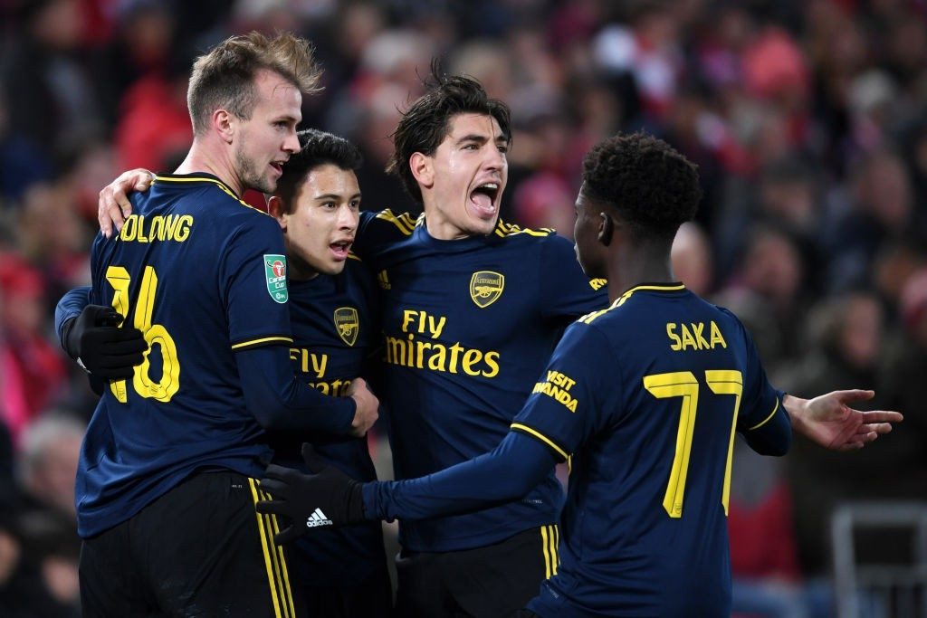 LIVERPOOL, ENGLAND - OCTOBER 30: Gabriel Martinelli of Arsenal celebrates after scoring his team's second goal with Rob Holding, Hector Bellerin and Bukayo Saka of Arsenal during the Carabao Cup Round of 16 match between Liverpool and Arsenal at Anfield on October 30, 2019, in Liverpool, England. (Photo by Laurence Griffiths/Getty Images)