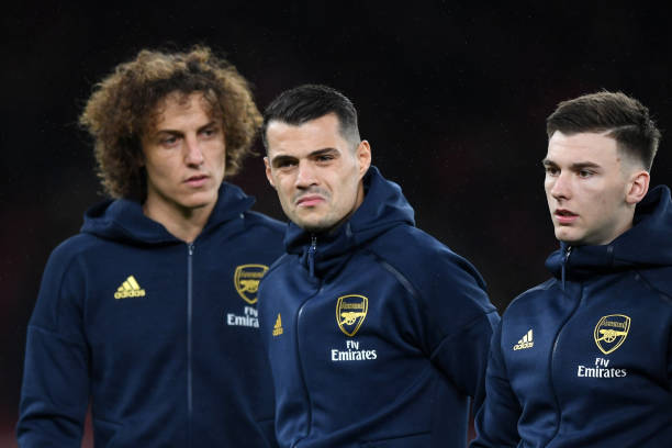 LONDON, ENGLAND - NOVEMBER 28: (L-R) David Luiz, Granit Xhaka and Kieran Tierney of Arsenal look on they line up ahead of the UEFA Europa League group F match between Arsenal FC and Eintracht Frankfurt at Emirates Stadium on November 28, 2019 in London, United Kingdom. (Photo by Shaun Botterill/Getty Images)