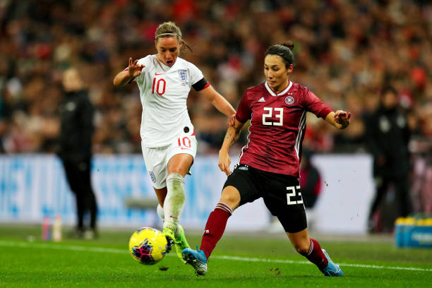 LONDON, ENGLAND - NOVEMBER 09: Jordan Nobbs of England and Sara Doorsoun of Germany battle for the ball during the International Friendly between England Women and Germany Women at Wembley Stadium on November 09, 2019 in London, England. (Photo by Catherine Ivill/Getty Images)